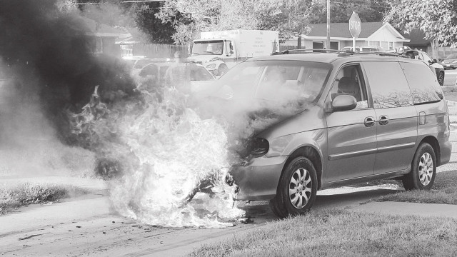 Officer's courageous effort helps spare one of two vehicles in fire